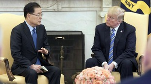 Seoul envoy South Korea's national security adviser Chung Eui-yong (L) meets U.S. President Donald Trump at the White House in Washington on March 8, 2018.