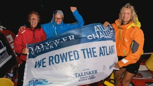 Elaine Theaker (right of picture) and her crew mates celebrate after rowing the Atlantic