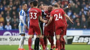 Huddersfield fail to break down 10-man Swansea in West Yorkshire