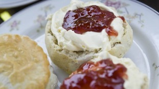 The offending advert - which has reignited debate about how to prepare cream scones.