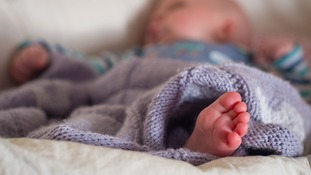 Cot death charity warns new parents over popular sleeping products