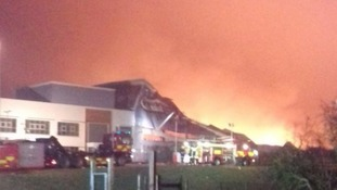 More than 50 firefighters tackle large warehouse fire