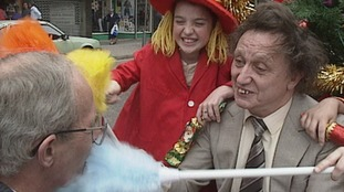 Tony Maycock being affectionately attacked by Ken Dodd's Diddy Men