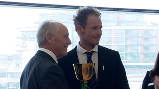 Tom Westley is presented with the trophy at Lord's.