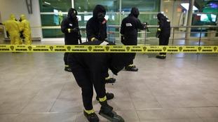 A hazardous materials team inspect Kuala Lumpur airport
