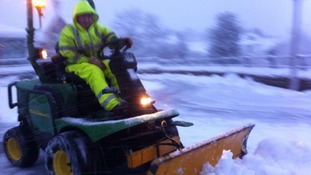Workers are using diggers to clear the streets of snow in Abergavenny, south Wales