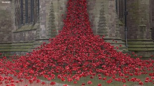 A cascade of red ceramic poppies in Hereford honours the war workers
