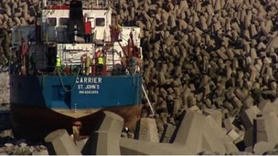 Workers on the ship grounded on rocks near Llanddulas