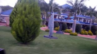 Statues of Mugabe adorn his garden.