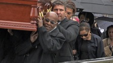 Chris Amoo helps carry the coffin of his brother Eddy at Liverpool Metropolitan Cathedral