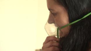 Woman using nebuliser