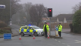 Police at the scene of the crash on Salhouse Road.