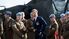 Prince Harry makes unusually 'political' statement on defence budget cuts at his former army training base