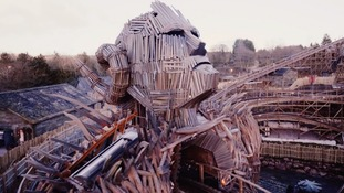 The wooden centre piece erupts in flames as the roller coaster hurtles through its body