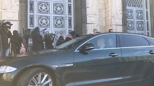 The driver kept the engine running as the media waited for the British ambassador to emerge.
