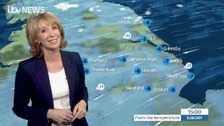 Emma Jesson in front of Calendar weather graphic