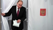 Vladimir Putin casts ballot as Russia heads to the polls