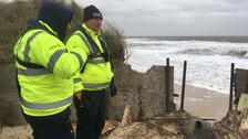 Coastguards examine the sea damage at Hemsby