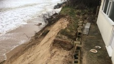 Coastal homes evacuated as cliffs crumble