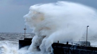 towering waves crashing over pier at Bridlington