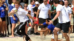 Prince Harry played some rugby with locals on Flamengo Beach in Rio de Janeiro, Brazil.