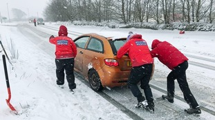 Motorists stranded by snow spend night at school shelter