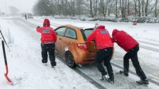 Motorists stranded by snow spend night at school