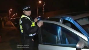 Police patrol at night to curb car crime.