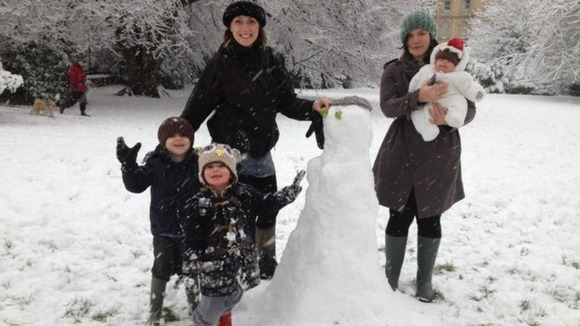 Family enjoy building snowman in Clifton  It&#x27;s not all doom and gloom - family in Clifton make the most of the snow.