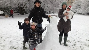 Family enjoy building snowman in Clifton  It's not all doom and gloom - family in Clifton make the most of the snow.