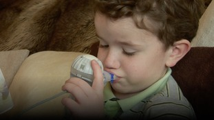 Six-year-old Elliott Raynor taking his medication.