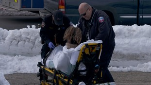 Emergency services help a woman who had overdosed on opioids.