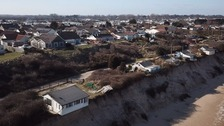 Homes start to crumble as tides batter Norfolk coast