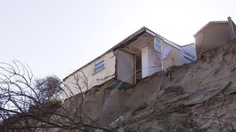 Cliff-top homes on the edge as coastal erosion intensifies
