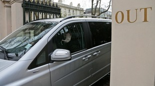 A car leaves the Russian embassy in London as Moscow waits for nearly two dozen Russian diplomats