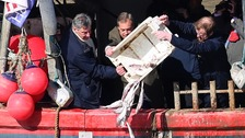 Nigel Farage dumps dead fish in protest over Brexit deal
