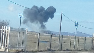 Plumes of smoke bellow from the wreckage of the Hawk T1 aircraft Corporal Jonathan Bayliss was flying in.