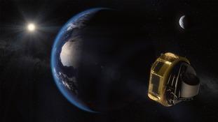 Satellite behind planet
