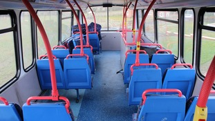 The inside of the double-decker bus