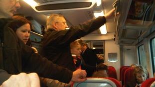 Passengers standing on train