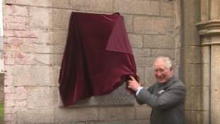 Prince Charles caught out in velvet curtain slip up