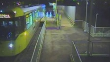 CCTV captures brutal attack on man at tram stop