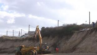 Demolition work begins on cliff-top homes battered on the Norfolk coast