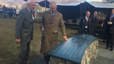 The Prince of Wales unveils a plaque declaring the Lake District a World Heritage Site