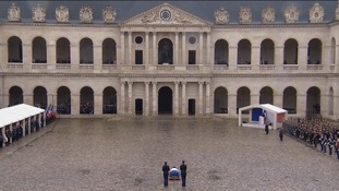 The ceremony was held in the stone courtyard of the French Interior Ministry.