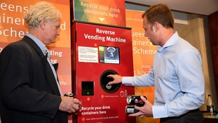 A reverse vending machine in Australia sees people get money for returning bottles and cans.