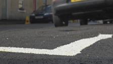 Car parked half-on / half-off pavement
