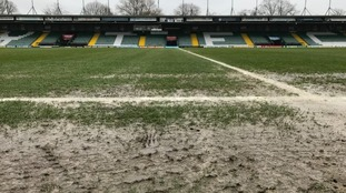 The League Two match has been postponed due to the waterlogged pitch.