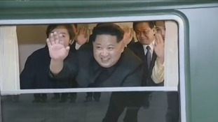 Kim Jong-un waves from his armoured train.
