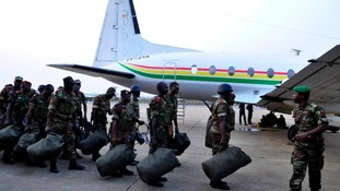 Benin soldiers line up to board a plane to Bamako, Mali